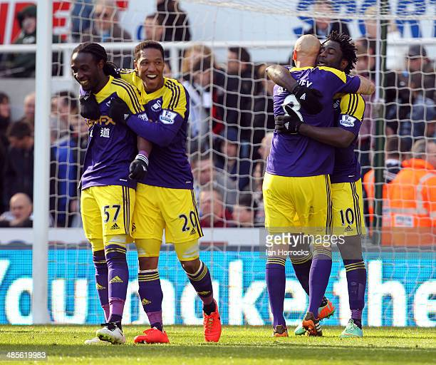 Swansea City players Kyle Bartley, Jonathan De Guzman, Jonjo Shelvey and goalscorer Wilfried Bony celebrate after the winning goal during the...
