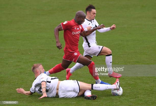 Swansea City players Mike van der Hoorn and Connor Roberts combine to thwart Benik Afobe of Bristol City during the Sky Bet Championship match...