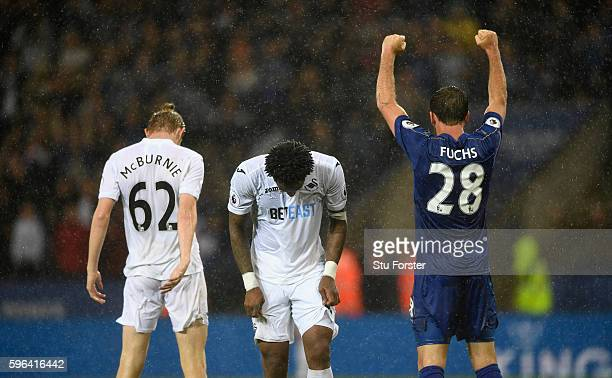Swansea City players Oliver McBurnie and Leroy Fer react as Leicester player Christian Fuchs celebrates on the final whistle during the Premier...