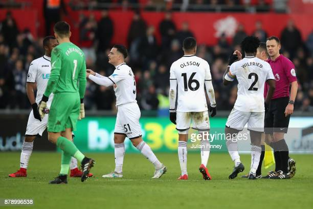 Swansea City players protest to match referee during the Premier League match between Swansea City and AFC Bournemouth at Liberty Stadium on November...