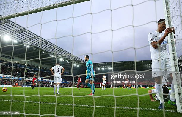 Swansea City players show their dejection after AFC Bournemouth's first goal during the Premier League match between Swansea City and AFC Bournemouth...