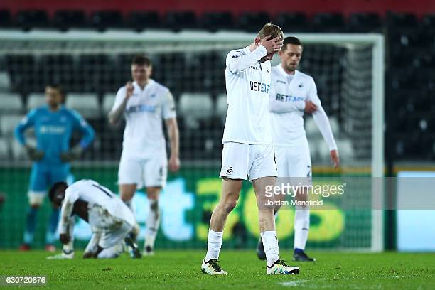 Swansea City players show their dejection after the Premier League match between Swansea City and AFC Bournemouth at Liberty Stadium on December 31...