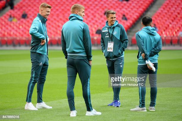 Swansea City players walk on the pitch prior to the Premier League match between Tottenham Hotspur and Swansea City at Wembley Stadium on September...
