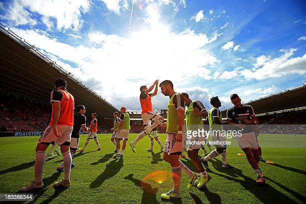 Swansea City players warm up prior to the Barclays Premier League match between Southampton and Swansea City at St Mary's Stadium on October 6 2013...