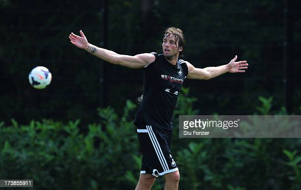 Swansea City striker Michu reacts during training at Landore training complex on July 18 2013 in Swansea Wales