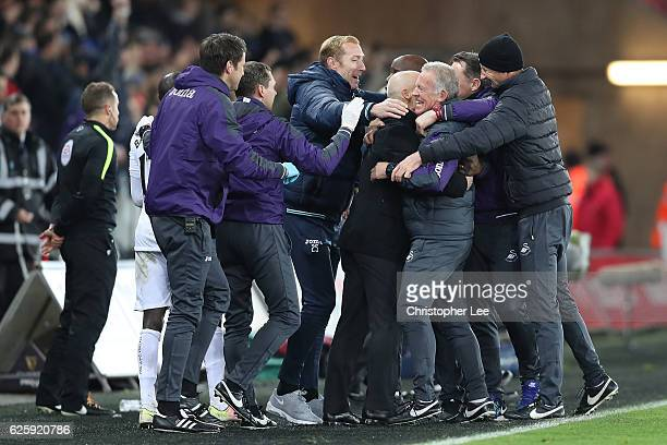 Swansea City team staffs celebrate their 54 win in the Premier League match between Swansea City and Crystal Palace at Liberty Stadium on November 26...