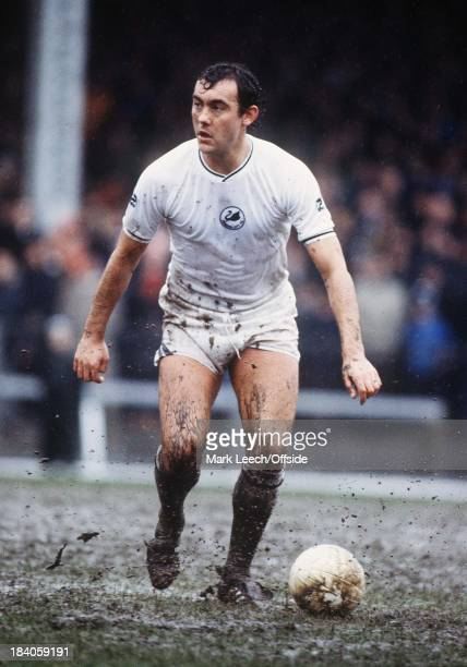 Swansea City v Stoke City Ray Kennedy controls the ball on the waterlogged pitch