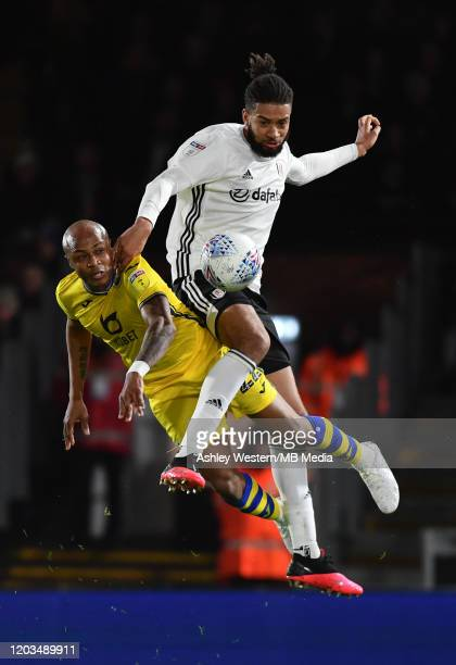 Swansea City's Andre Ayew competes for the ball with Fulham's Michael Hector during the Sky Bet Championship match between Fulham and Swansea City at...