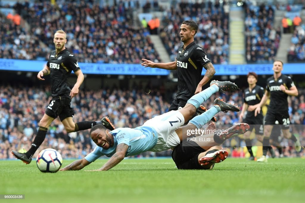 Swansea City's Argentinian defender Federico Fernandez fouls Manchester City's English midfielder Raheem Sterling to concede a penalty during the English Premier League football match between Manchester City and Swansea at the Etihad Stadium in Manchester, north west England, on April 22, 2018. (Photo by Paul ELLIS / AFP) / RESTRICTED TO EDITORIAL USE. No use with unauthorized audio, video, data, fixture lists, club/league logos or 'live' services. Online in-match use limited to 75 images, no video emulation. No use in betting, games or single club/league/player publications. /