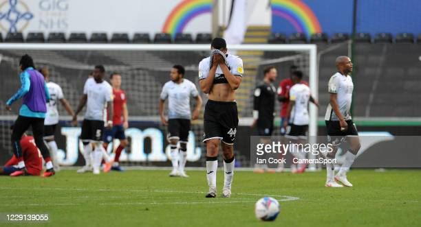 Swansea City's Ben Cabango looks dejected at the final whistle during the Sky Bet Championship match between Swansea City and Huddersfield Town at...
