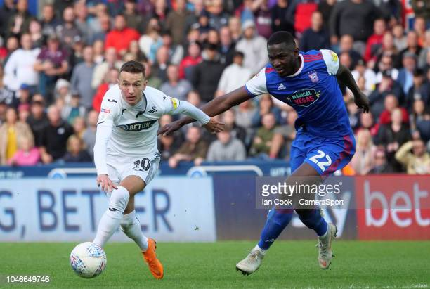 Swansea City's Bersant Celina gets away from Ipswich Town's Aristote Nsiala and goes onto score Swansea City's second goal during the Sky Bet...