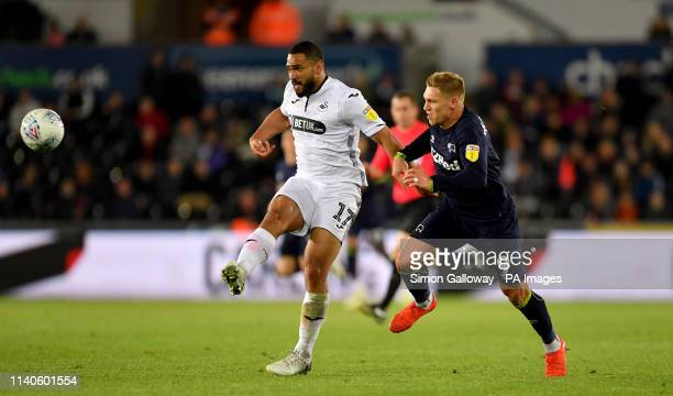 Swansea City's Cameron CarterVickers and Derby County's Martyn Waghorn battle for the ball during the Sky Bet Championship match at the Liberty...
