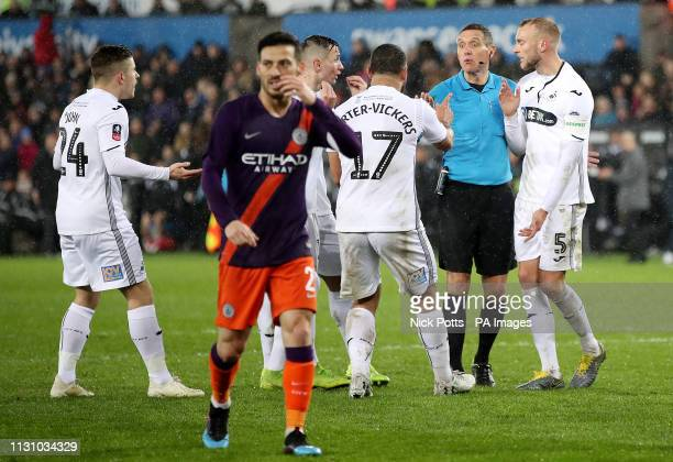 Swansea City's Cameron CarterVickers appeals to match referee Andre Marriner during the FA Cup quarter final match at the Liberty Stadium Swansea