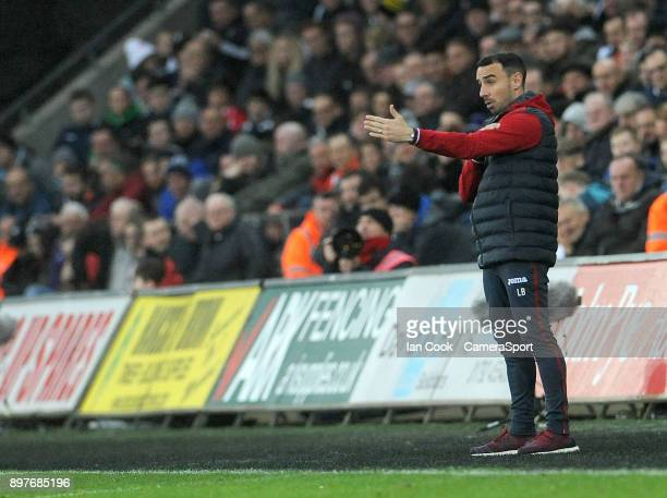 SWANSEA WALES DECEMBER Swansea City's caretaker playermanager Leon Britton shouts instructions from the technical area during the Premier League...