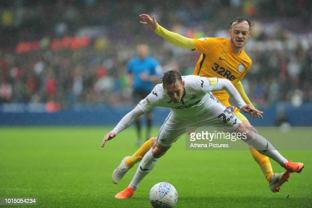 Swansea City's Connor Roberts is fouled by Preston North End's Brandon Barker during the Sky Bet Championship match between Swansea City and Preston...
