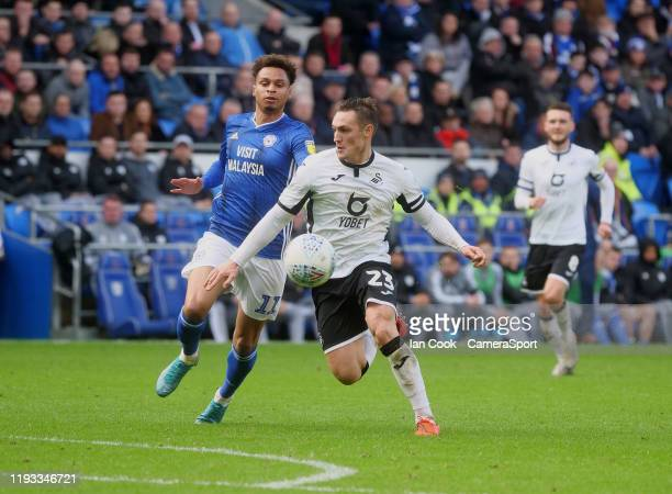 Swansea City's Connor Roberts shields the ball from Cardiff City's Josh Murphy during the Sky Bet Championship match between Cardiff City and Swansea...