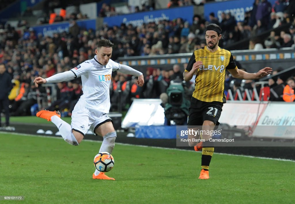 Swansea City's Connor Roberts under pressure from Sheffield Wednesday's George Boyd during the The Emirates FA Cup Fifth Round Replay match between Swansea City and Sheffield Wednesday at Liberty Stadium on February 27, 2018 in Swansea, Wales.