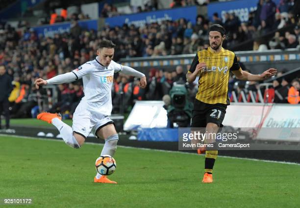 Swansea City's Connor Roberts under pressure from Sheffield Wednesday's George Boyd during the The Emirates FA Cup Fifth Round Replay match between...