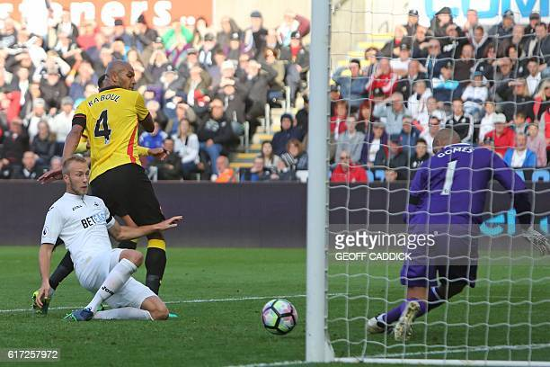 Swansea City's Dutch defender Mike van der Hoorn misses with this attempt on goal during the English Premier League football match between Swansea...
