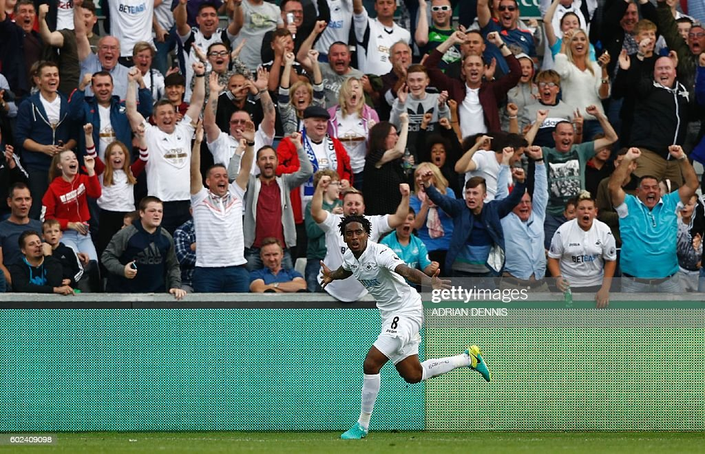 Swansea City's Dutch midfielder Leroy Fer celebrates after scoring their second goal during the English Premier League football match between Swansea City and Chelsea at The Liberty Stadium in Swansea, south Wales on September 11, 2016. / AFP / Adrian DENNIS / RESTRICTED TO EDITORIAL USE. No use with unauthorized audio, video, data, fixture lists, club/league logos or 'live' services. Online in-match use limited to 75 images, no video emulation. No use in betting, games or single club/league/player publications. /