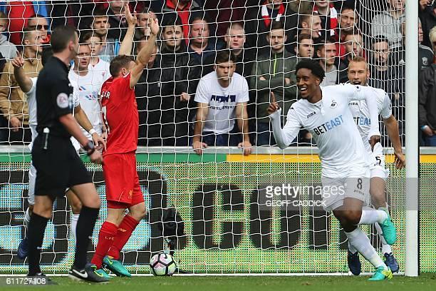 Swansea City's Dutch midfielder Leroy Fer celebrates scoring the opening goal during the English Premier League football match between Swansea City...