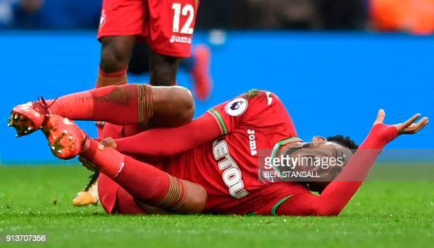 Swansea City's Dutch midfielder Leroy Fer reacts on the ground injured during the English Premier League football match between Leicester City and...