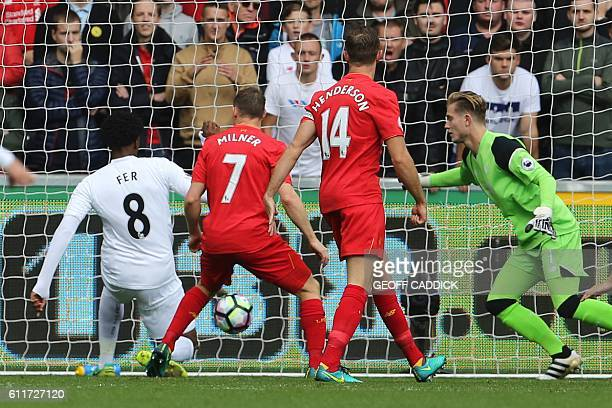 Swansea City's Dutch midfielder Leroy Fer scores the opening goal during the English Premier League football match between Swansea City and Liverpool...