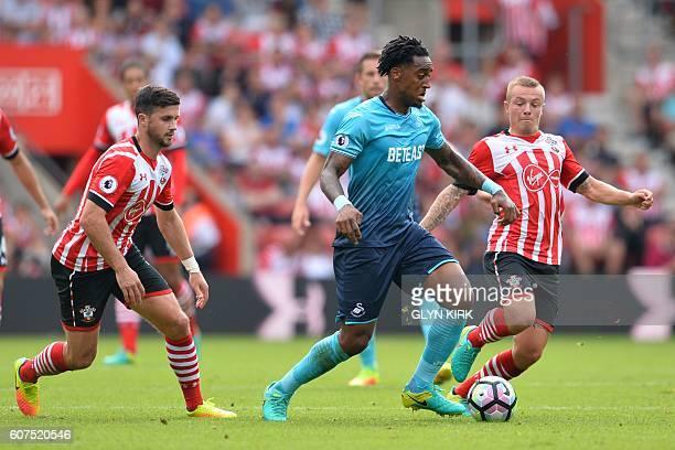 Swansea City's Dutch midfielder Leroy Fer vies with Southampton's Dutch midfielder Jordy Clasie during the English Premier League football match...