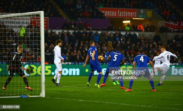 Swansea City's English defender Alfie Mawson shoots to score the opening goal of the English Premier League football match between Swansea City and...