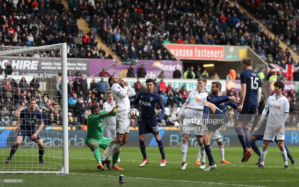 Swansea City's English defender Kyle Bartley (2L) blocks a shot from Tottenham Hotspur's Spanish striker Fernando Llorente (3R) during the English FA Cup quarter-final football match between Swansea City and Tottenham Hotspur at The Liberty Stadium in Swansea, south Wales on March 17, 2018. / AFP PHOTO / Daniel LEAL-OLIVAS / RESTRICTED TO EDITORIAL USE. No use with unauthorized audio, video, data, fixture lists, club/league logos or 'live' services. Online in-match use limited to 75 images, no video emulation. No use in betting, games or single club/league/player publications. /
