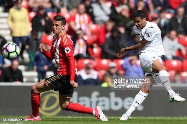 Swansea City's English defender Kyle Naughton shoots past Sunderland's Spanish defender Javier Manquillo to score their second goal during the...