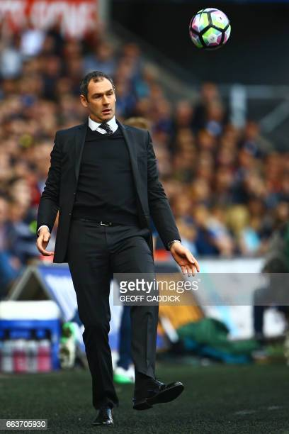 Swansea City's English head coach Paul Clement attempts to control the ball as it goes out of play during the English Premier League football match...
