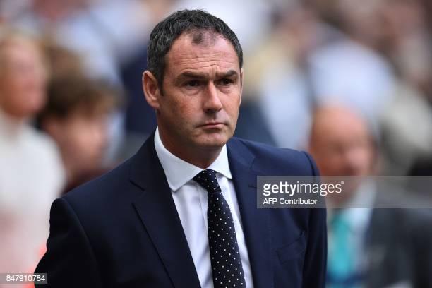 Swansea City's English head coach Paul Clement awaits kick off ahead of the English Premier League football match between Tottenham Hotspur and...