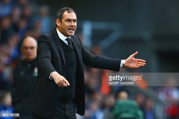 Swansea City's English head coach Paul Clement gestures on the touchline during the English Premier League football match between Swansea City and...