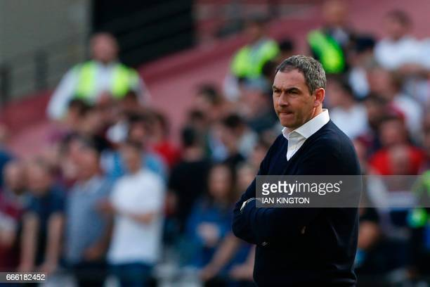 Swansea City's English head coach Paul Clement reacts during the English Premier League football match between West Ham United and Swansea City at...
