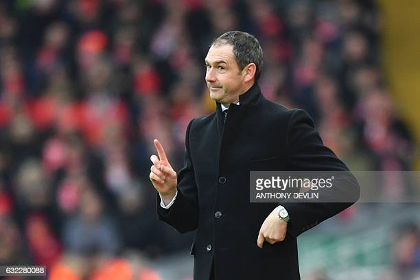 Swansea City's English head coach Paul Clement reacts on the touchline during the English Premier League football match between Liverpool and Swansea...