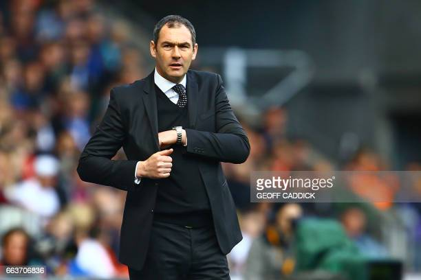 Swansea City's English head coach Paul Clement watches from the touchline during the English Premier League football match between Swansea City and...