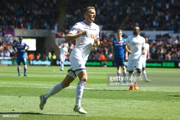 Swansea City's English midfielder Andy King celebrates after scoring during the English Premier League football match between Swansea City and Stoke...