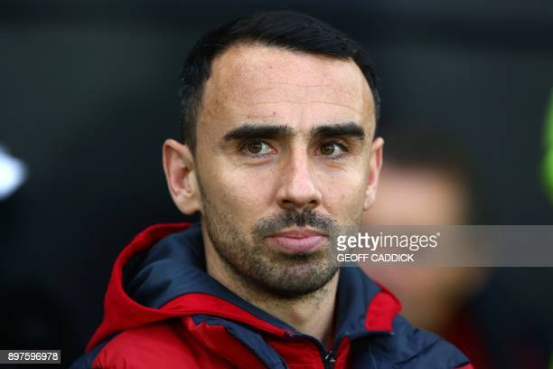 Swansea City's English midfielder Leon Britton interim manager awaits kick off in the English Premier League football match between Swansea City and...