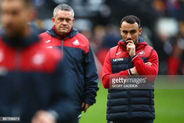 Swansea City's English midfielder Leon Britton interim manager on the pitch ahead of the English Premier League football match between Swansea City...