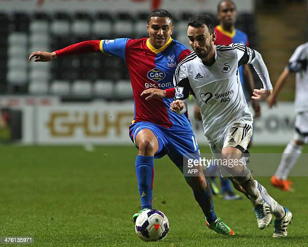 Swansea City's English midfielder Leon Britton vies with Crystal Palace's English midfielder Jerome Thomas during the English Premier League football...