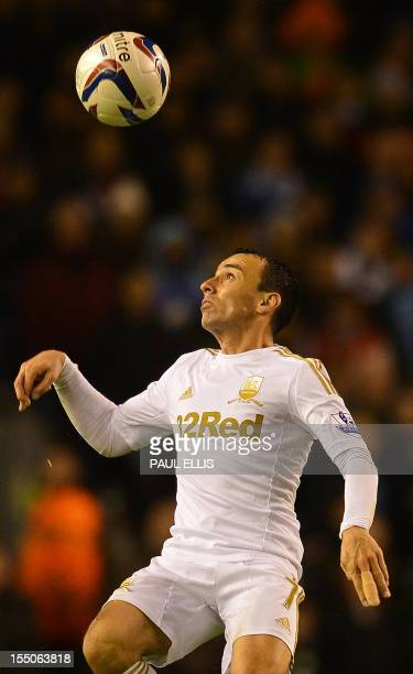 Swansea City's English midfielder Leon Britton watches the ball during the English League Cup Fourth Round football match between Liverpool and...