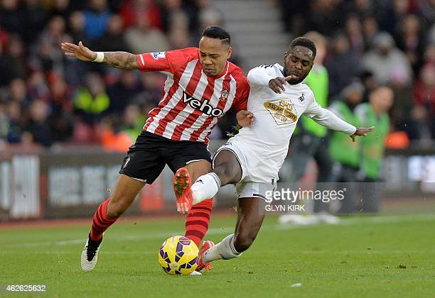 Swansea City's English midfielder Nathan Dyer vies for the ball with Southampton's English defender Nathaniel Clyne during the English Premier League...