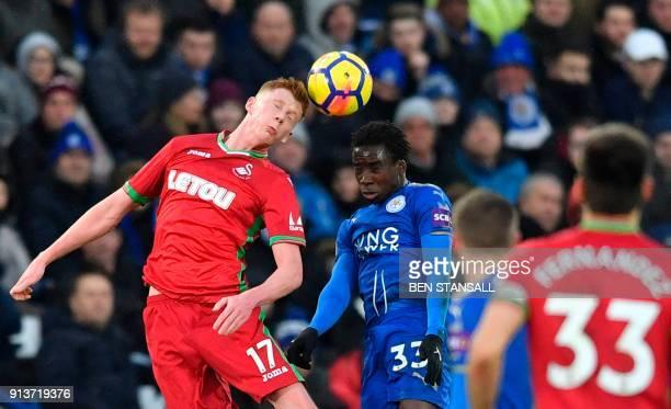 Swansea City's English midfielder Sam Clucas outjumps Leicester City's Malian midfielder Fousseni Diabate during the English Premier League football...