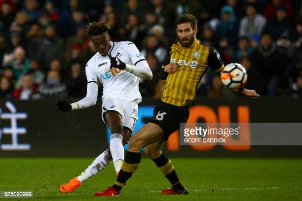 Swansea City's English striker Tammy Abraham takes a shot at goal past Sheffield Wednesday's Portuguese defender Frederico Venancio during the...
