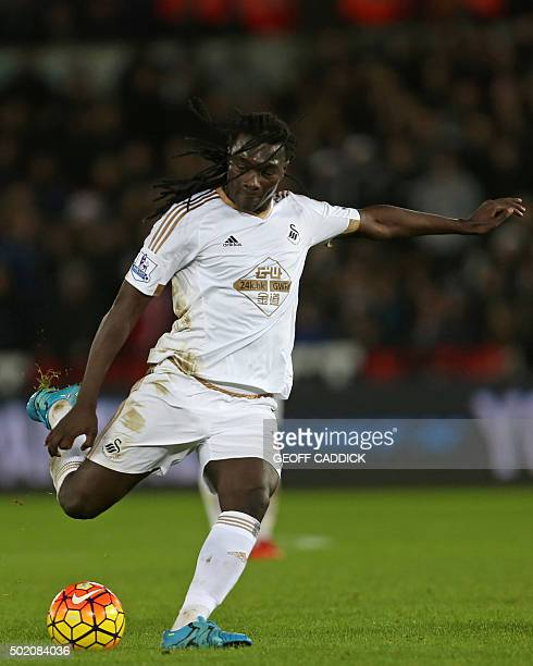 Swansea City's French striker Bafetimbi Gomis prepares to shoot during the English Premier League football match between Swansea City and West Ham...