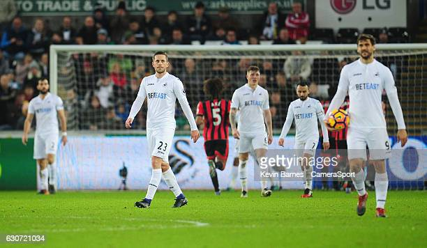 Swansea City's Gylfi Sigurdsson looks dejected as Bournemouth celebrate their second goal during the Premier League match between Swansea City and...