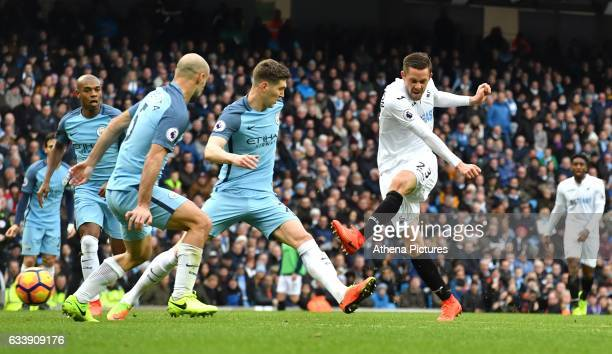 Swansea City's Gylfi Sigurdsson scores the equaliser for Swansea City during the Premier League match between Manchester City and Swansea City at the...