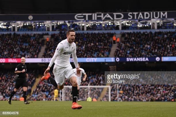 Swansea City's Icelandic midfielder Gylfi Sigurdsson celebrates after scoring their first goal during the English Premier League football match...