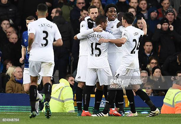 Swansea City's Icelandic midfielder Gylfi Sigurdsson celebrates scoring his team's first goal from the penalty spot during the English Premier League...